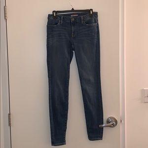 Tommy Hilfifer medium wash skinny jeans.